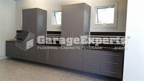 grey garage cabinets   granite floor garage experts