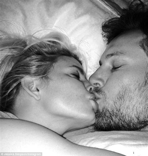 kiss bed jessica simpson puckers up to fianc 233 eric johnson for a