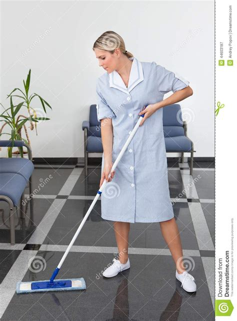 Maid Cleaning  Floor Stock Photo Image