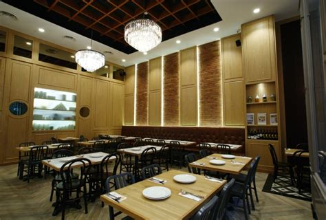 How To Mix And Match Furniture For Living Room zaffron kitchen restaurant by jp concept singapore