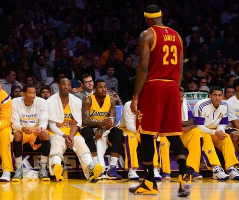 kobe bryant bench cavaliers lebron james chats with the lakers kobe bryant