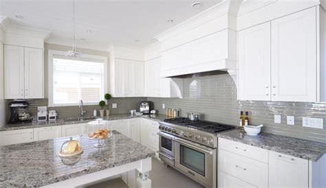 White Kitchen Cabinets Gray Granite Countertops by White Cabinets Grey Glass Backsplash And Med Grey Granite