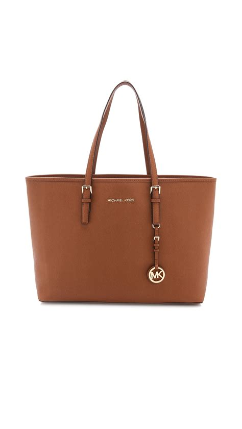 michael michael kors jet set travel leather tote in gold
