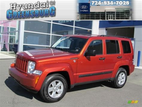 red jeep liberty 2009 2009 sunburst orange pearl jeep liberty sport 4x4