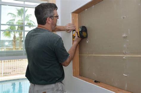 built   wall shelving reclaiming hidden storage