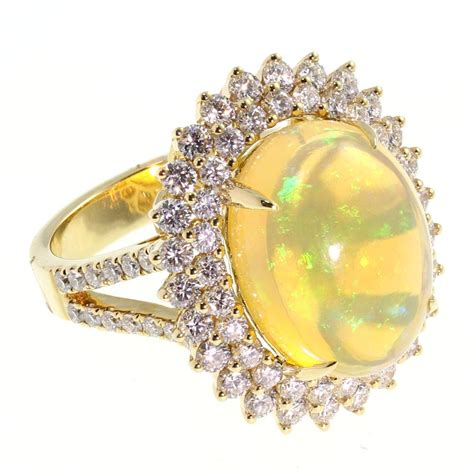 1550 Ct Jumbo Size Yellow Opal 18ct yellow gold large oval shape opal ring from mr harold and jewellery uk