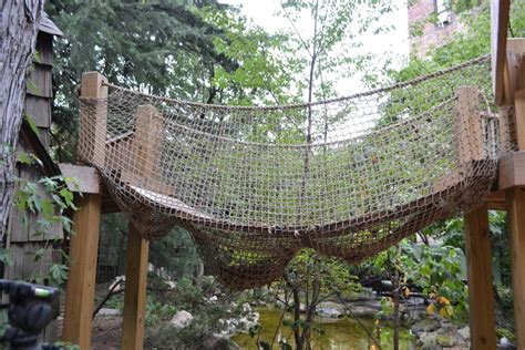 backyard rope bridge natural playscapes pond and playground oasis in city backyard