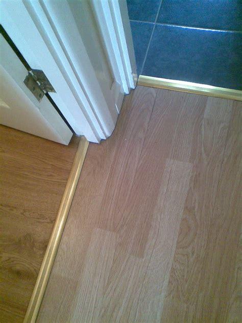 laminate flooring hiding exp gap under skirt   Flooring