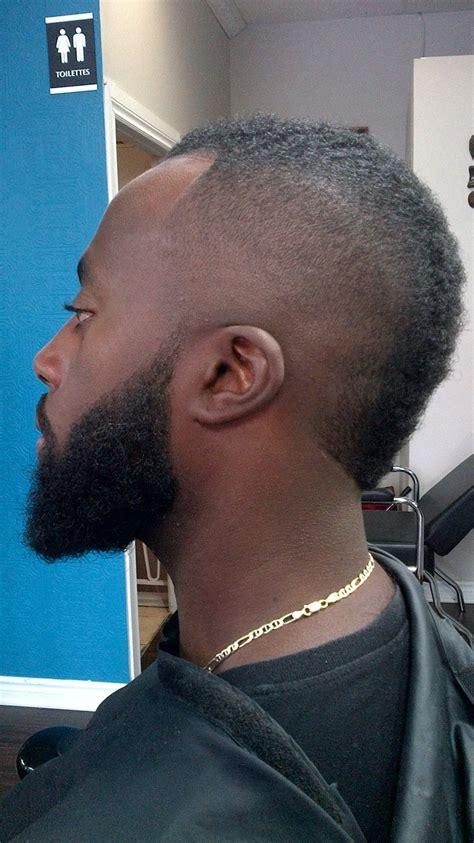 mohawk fade on black men mohawk bald fade beard lining rylc barber styling
