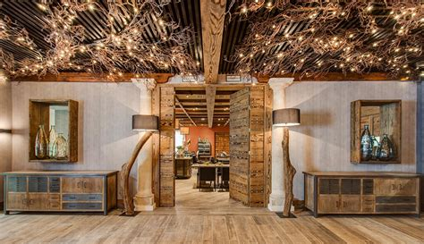 rustic interior design meets luxury in this gastrobar in spain