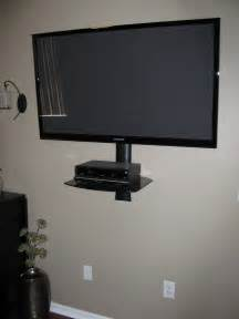 gray solid wood floating cabinet as tv stand under light