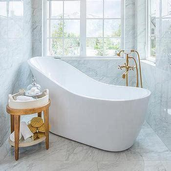 angled bathtub marble steps to freestanding tub transitional bathroom