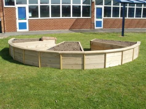curved bespoke raised bed potager front yard garden