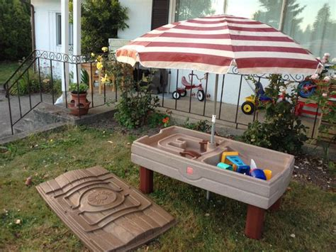 sand table with umbrella 2 naturally playful sand water table with umbrella