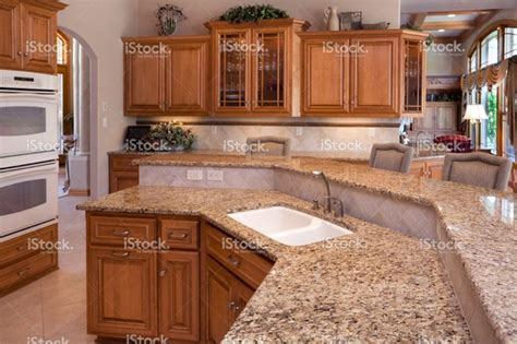 custom luxury eat in kitchen with granite counters oak