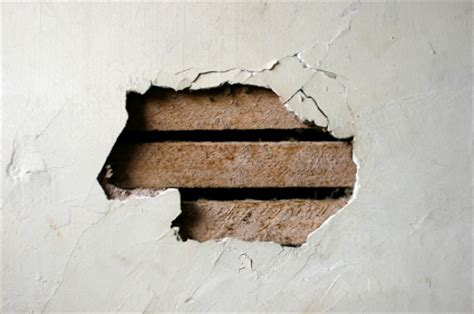 fix hole in wall attaching repairing and hanging things on plaster walls