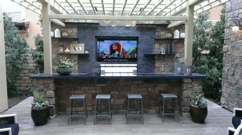 French House entertainment wall and bar w bbq outdoor dining