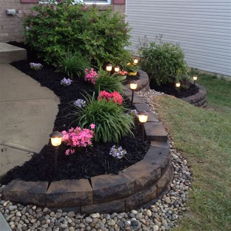 rock flower beds rock retaining wall premium mulch rocks and low voltage