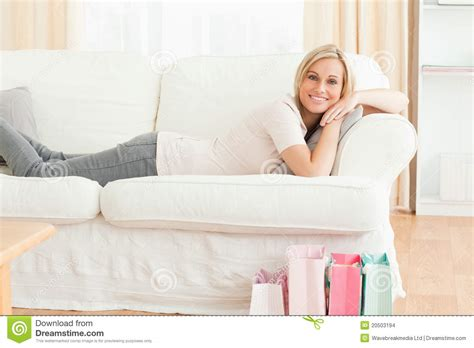 laid on the couch woman lying on her couch after shopping stock images