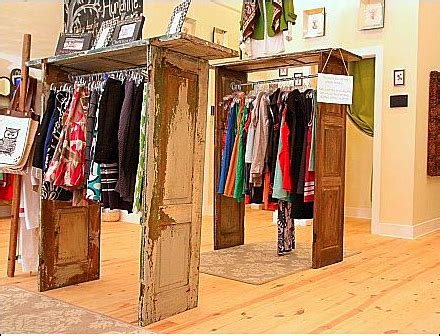 Store Racks For Clothing by Shutter Door Clothing Racks Fixtures Up Retail Pop