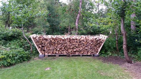 diy firewood rack cinder blocks how to build a bad firewood rack with no tools in 15 minutes eco snippets
