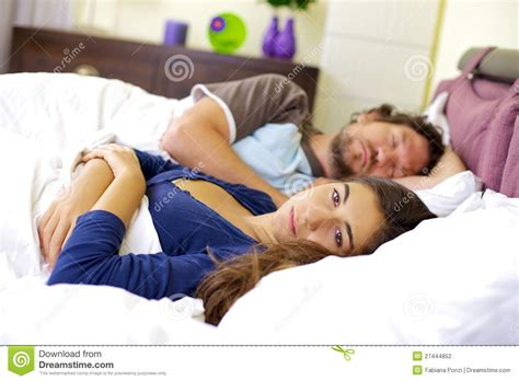 my boyfriend is bad in bed sad woman in bed with sleeping husband stock photography