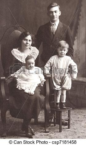 an old time family. a mother, father, and two children