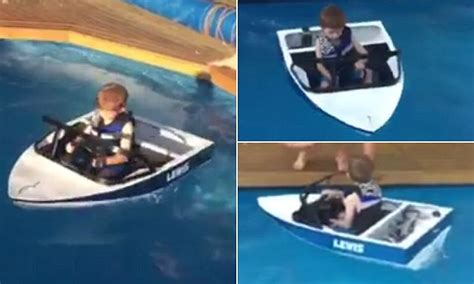 mini boat for child australian kid glides across his pool in a homemade mini
