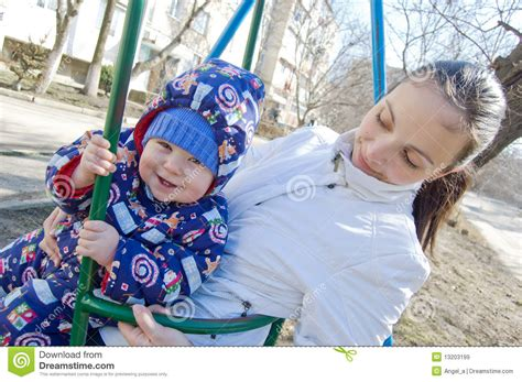 mom swings baby around baby boy and his mother on swing royalty free stock images