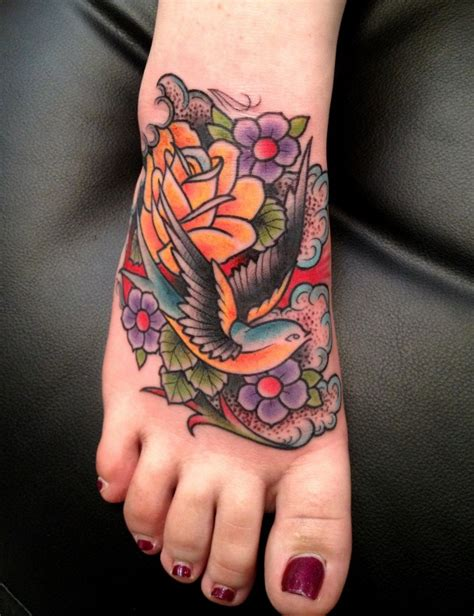 swallow and rose tattoo and foot luke wessman soho nyc luke