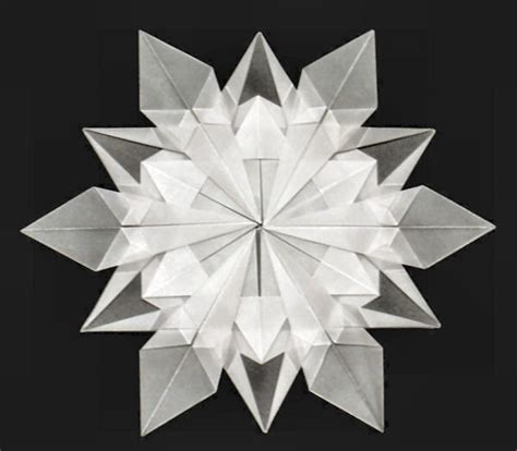 Folded Paper Snowflakes - more origami inspiration for irina kruzhilina this time