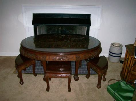 Carved Coffee Table With Stools by Carved Oval Coffee Table With 6 Stools