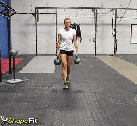 walking kettlebell swing kettlebell farmer s walk crossfit exercise guide with photos