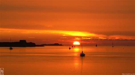 boats coming back at sunset 1920 215 1080 desktop wallpaper