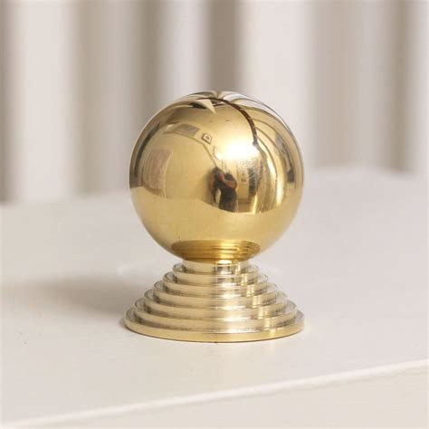 step cabinet knob brass