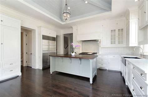 white kitchen with marble top island white glass kitchen kitchens gray ceiling two tone kitchen white glass front