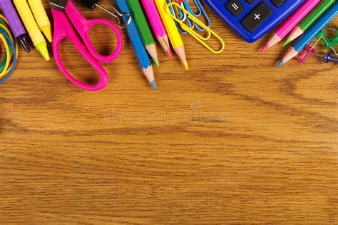 school supplies top border  wood desk stock photo