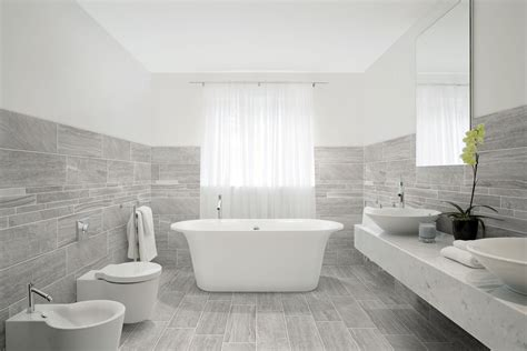 Porcelain Tile With Mixed Look Of Wood Stone And Concrete From Marmomix Grey In A Bathroom Scene