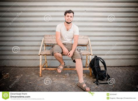 man bench stylish man sitting on a bench royalty free stock