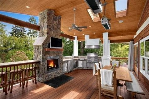 this covered deck has it all there is a fireplace with a