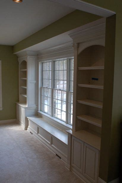 window bench and bookshelves bookshelves and window seat built around a large window