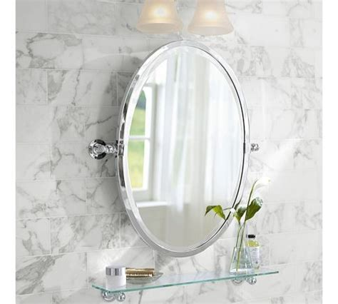 In the half bath, I like an oval mirror or recessed