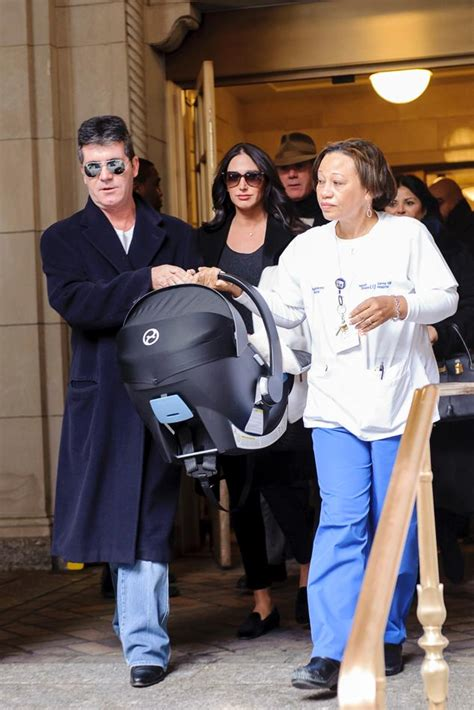 simon cowell and lauren silverman leave baby eric at home simon cowell cradles newborn son in first photos ny