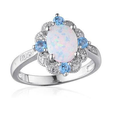 oval lab created opal white sapphire and swiss blue topaz