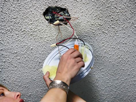 How Do I Wire A Light Fixture How To Replace A Light Fixture With A Ceiling Fan How Tos Diy