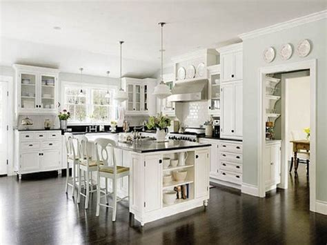 antique white kitchen with wood floors and an antique white kitchen cabinets with wood floors