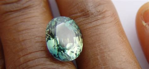 Sphene 2 47 Cts blue green sapphire 5 47 cts
