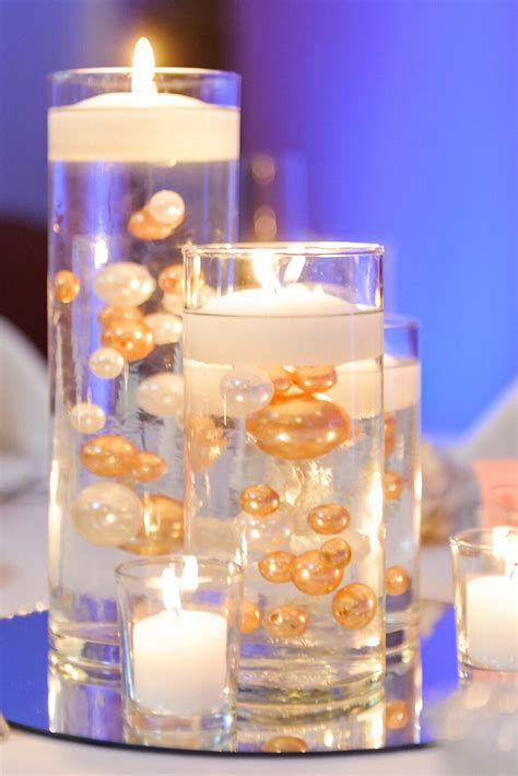 floating candle centerpieces  gold  white pearls