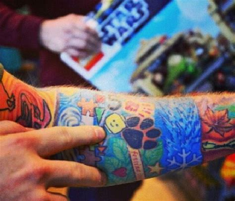 what is ed sheeran s tattoo on his right arm lego man tattoo