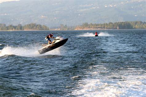 jet ski river boat columbia river jet boat jet skier jumping our wake